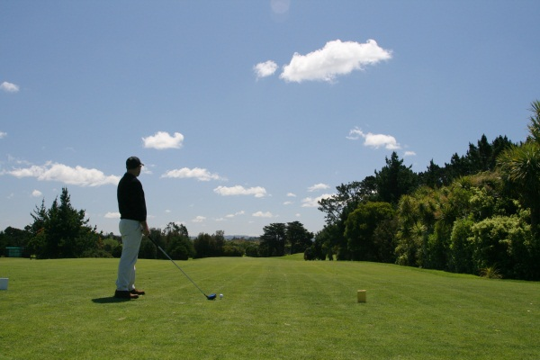 man with driver at tee off